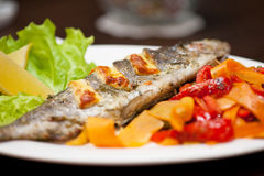 Rainbow trout fish. Tasty dish of rainbow trout fish with vegetables Stock Photography