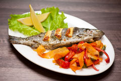 Rainbow trout fish. Tasty dish of rainbow trout fish with vegetables Stock Photos