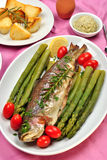 rainbow trout with organic green asparagus royalty free stock photo