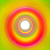 Rainbow tunnel made out of slinky leading to white background Stock Images