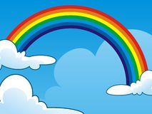 Rainbow between two Clouds on Clear Blue Sky Stock Photo