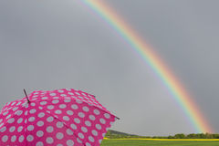Rainbow with umbrella Royalty Free Stock Photography