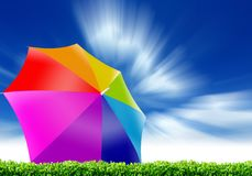 Rainbow umbrella and blue sky Stock Photo