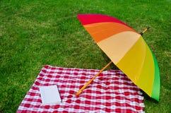 Rainbow umbrella and book Royalty Free Stock Photos