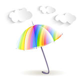 Rainbow umbrella and clouds Stock Photography