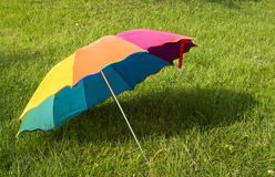 Rainbow umbrella on the grass background Stock Image