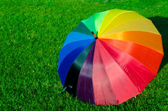 Rainbow umbrella on the grass Stock Photo