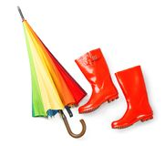 Rainbow umbrella with gumboots. On white background Stock Images