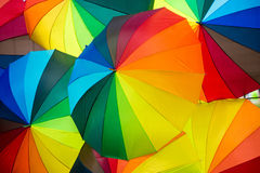 Rainbow umbrella Stock Images