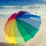 Rainbow umbrella by the ocean Royalty Free Stock Photography