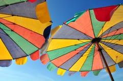 Rainbow umbrella on sky background Stock Photos