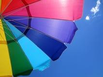 Rainbow Umbrella. Under a blue sky at Ocean City, Maryland stock image