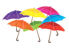 Rainbow umbrellas. Rainbow colored umbrellas randomly overlapped on white background Stock Images