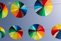 Rainbow umbrellas Stock Images