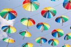 Rainbow umbrellas Stock Photography