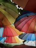Rainbow umbrellas. Roof colorful photograph Stock Photos