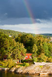 Rainbow under small village Stock Image