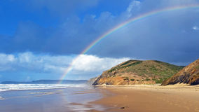 Rainbow on Vale Figueiras beach in Portugal. Europe Stock Image
