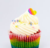 Rainbow valentine cupcake with heart top Royalty Free Stock Image