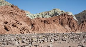 Rainbow Valley Valle Arcoiris, in the Atacama Desert in Chile. The mineral rich rocks of the Domeyko mountains give the valley t. He varied colors from red to royalty free stock photo