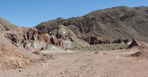 Rainbow Valley Valle Arcoiris, in the Atacama Desert in Chile. The mineral rich rocks of the Domeyko mountains give the valley t. He varied colors from red to stock photos