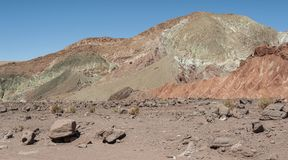 Rainbow Valley Valle Arcoiris, in the Atacama Desert in Chile. The mineral rich rocks of the Domeyko mountains give the valley t. He varied colors from red to royalty free stock photos