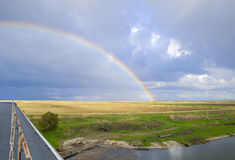 Rainbow, view from the roof of the building. Royalty Free Stock Photo
