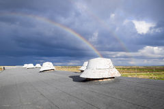 Rainbow, view from the roof of the building. Ventilation outlets Royalty Free Stock Photography