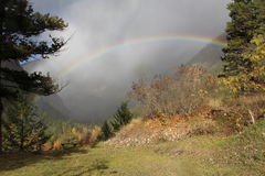 Rainbow Viewpoint. A magnificent rainbow arcs over a viewpoint at Hedley on a beautiful misty but sun dappled autumn day Stock Photos