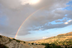 Rainbow on the village Royalty Free Stock Image