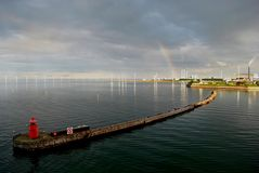 Rainbow visible by Danish offshore wind farm Royalty Free Stock Photo