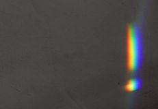 Rainbow on the Wall. Optimistic exclamation mark on a dark gray wall Stock Image