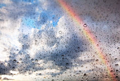 Rainbow and water drops on glass texture Stock Images