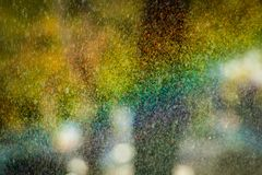 Rainbow water drops on sun background abstract. Flares colorful macro Stock Photo