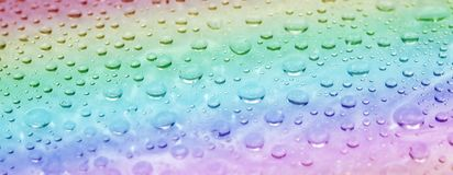 Rainbow water drops surface. Abstract summer background royalty free stock images