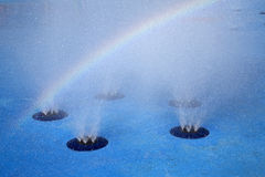 Rainbow and water fountain. Beautiful rainbow and water fountain background Royalty Free Stock Photo