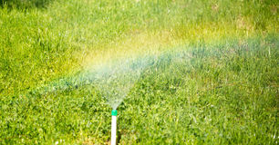 Rainbow from a water fountain in the nature Stock Image