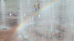 Rainbow and water fountain in sunny day, environment, stock footage