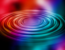 Rainbow water ripples Royalty Free Stock Photos