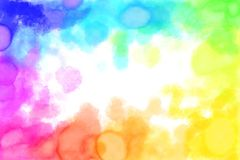 Rainbow Watercolour Blots Background. Watercolours in the Rainbow Spectrum around the edge of the Background Stock Photos
