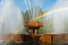 Rainbow in the waterdrops of a fountain. Almaty, Kazakhstan Royalty Free Stock Photo