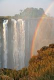 Rainbow waterfall. A rainbow is created by the Victoria waterfall in Zambia Royalty Free Stock Image