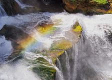 Rainbow and Waterfall Stock Images