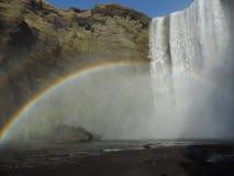 Rainbow at waterfall Skogafoss, Iceland stock photos