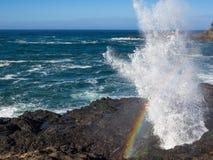 Rainbow at wave splash Royalty Free Stock Images