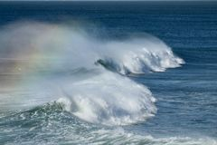 Rainbow waves on a windy day in Southern California. Due to offshore winds Stock Photo