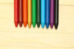 Rainbow  wax crayons  on wood Stock Photos
