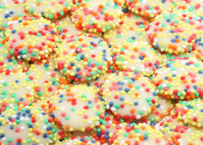 Rainbow White Chocolate Drops. All time childrens favourite confectionary - white chocolate drops with multicoloured sprinkles Royalty Free Stock Photography