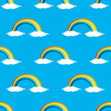 Rainbow and white clouds. Stock Photo