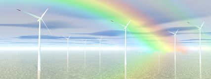 Rainbow and wind turbines Royalty Free Stock Photography